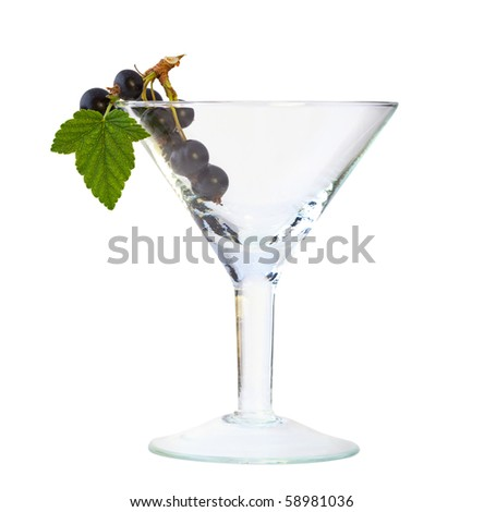 Close-up of black currant bunch in glass isolated over white - stock photo