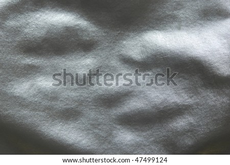 close up of black leather fabric with lumpy texture. - stock photo