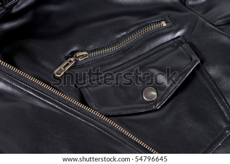 Close up of black leather jacket. Pocket and zipper. - stock photo
