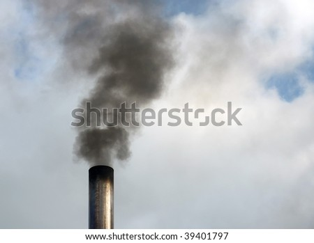 Close up of black smoke rising from chimney