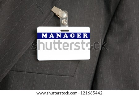 Close Up of Black Suit with Manager ID Card - stock photo