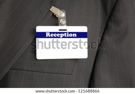 Close Up of Black Suit with Reception ID Card - stock photo