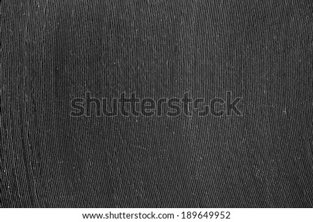 close up of black vinyl surface with song paths - stock photo