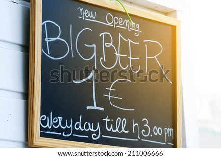 Close up of blackboard advertising beer prices outside a bar in Corralejo Fuerteventura - stock photo