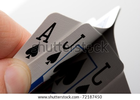 Close-up of blackjack cards in palm of hand - stock photo
