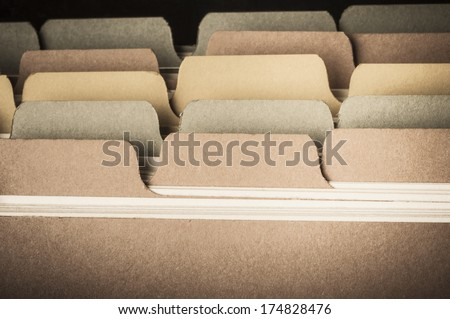 Close up of blank cardboard index cards photographed from front.  Low saturation hues and vignette applied to give a vintage feel.  Left blank to provide copy space. - stock photo