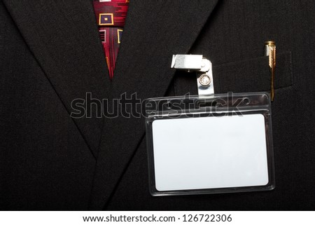 close up of blank id card on man's suit - stock photo