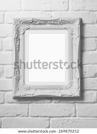 Close up of blank picture frame at the brick wall with clipping path - stock photo