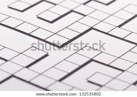 Close up of blank square crossword puzzle. - stock photo