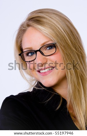 Close up of blond young businesswoman wearing eye glasses who smiles at camera. - stock photo