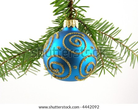Close-up of blue  Christmas bauble on tree against white background
