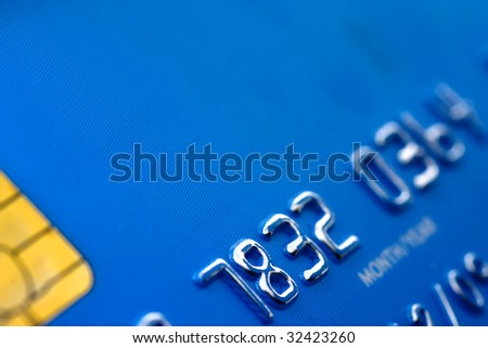 Close up of blue credit card with partial code and security microchip - stock photo