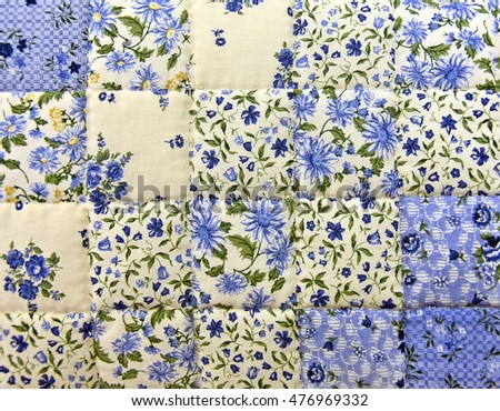 close up of blue floral calico quilt square pattern