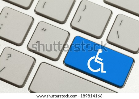 Close Up of Blue Handicap Key Button on a Keyboard. - stock photo