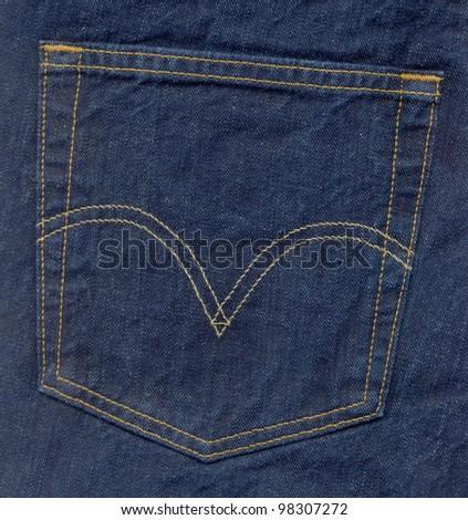 Close up of blue jeans back pocket - stock photo