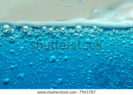 Close-up of blue soap and bubbles - stock photo