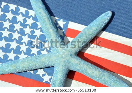 Close up of blue starfish with flag background - stock photo
