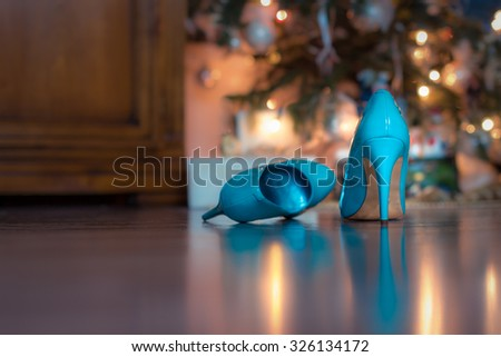 close-up of blue / turquoise party shoes with golden bottom. Selective focus. - stock photo