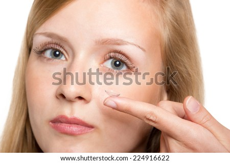 Close-up of blue woman eye with contact lens applying - stock photo