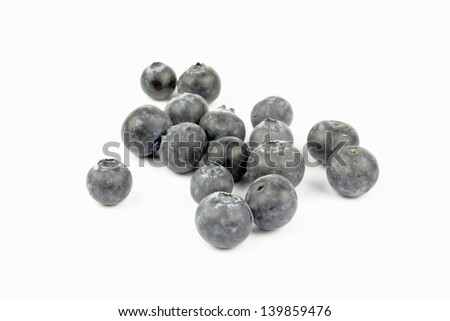 Close up of blueberries on the white background
