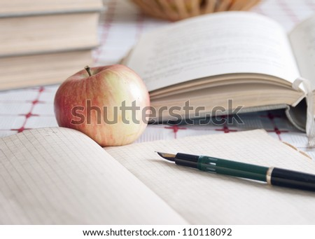 close up of books and volumes on the table - stock photo