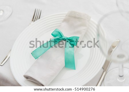 close up of  bow on a napkin in a restaurant. serving table