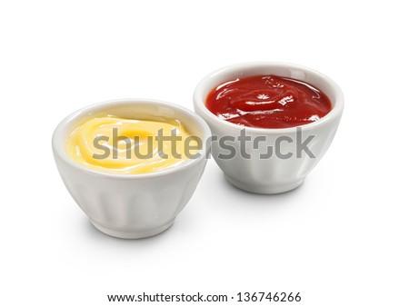 close up of bowls of tomato ketchup and mayonnaise - stock photo
