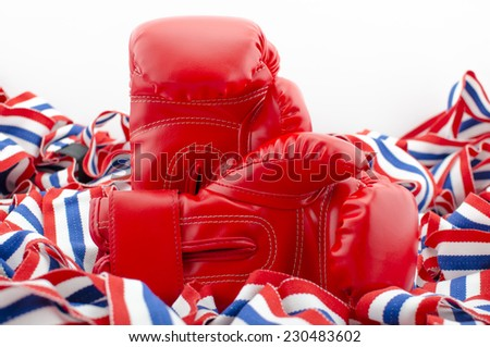Close Up of Boxing Gloves Red Leather Isolated on white for background, wallpaper or texture. - stock photo