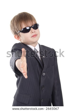 Close-up of boy in business suit. Shot in studio. Isolated with clipping path. - stock photo