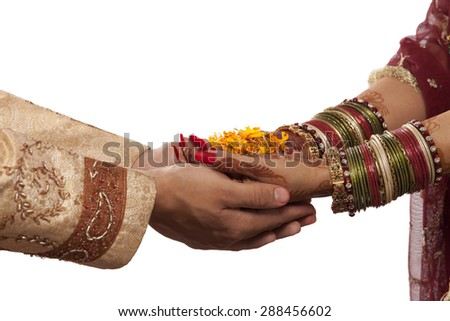 Close Up Of Bride And Grooms Hands With Marigold