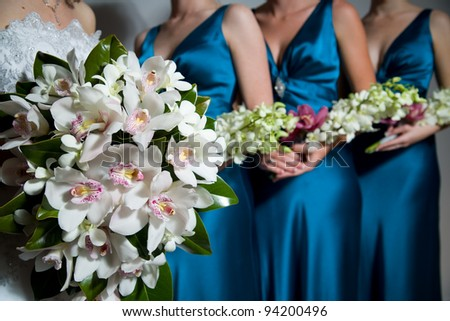 Close up of Bride's bouquet with Bridesmaids bouquets in the background - stock photo