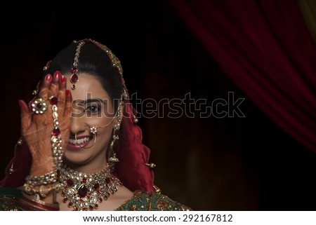 Close up of bride with one hand in front of her eye
