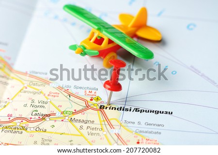Close up of  Brindisi , Italy map with red pin and airplane   - Travel concept - stock photo