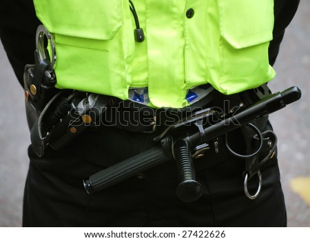 Close-up of British policeman wearing protection equipment - stock photo