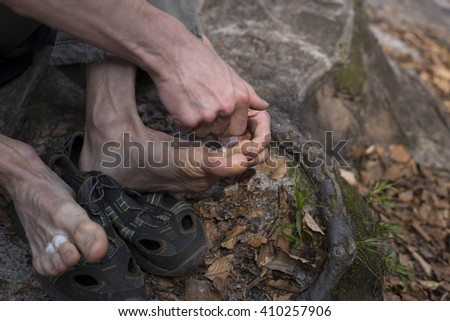 close up of brown adhesive medical patch on male knee - stock photo