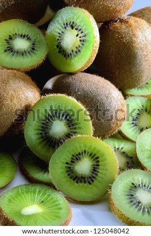 close-up of brown kiwi with green slices - stock photo