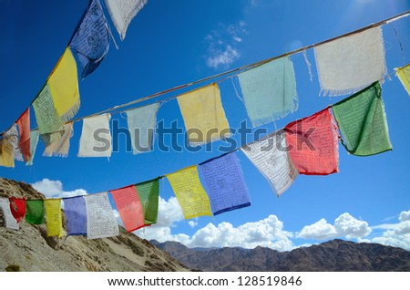 Close up of buddhist prayer flags on a sky background in Himalayas - stock photo