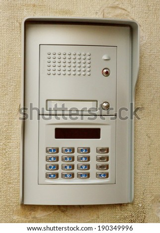 Close-up of building intercom on a wall - stock photo