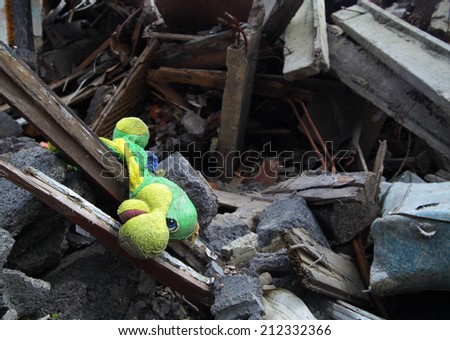 Close up of building ruins with toy on foreground.  - stock photo