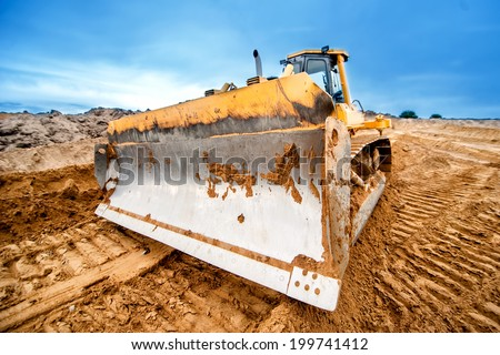 close-up of bulldozer blade, industrial machines working in sandpit on construction site - stock photo