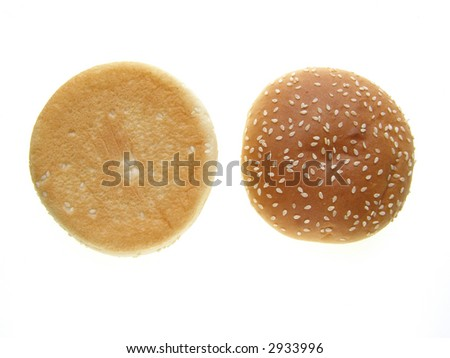 Close-up of burger bun with sesame seeds on white background
