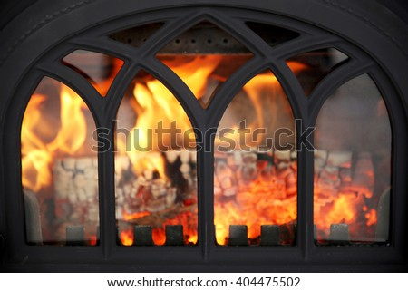 Close up of burning fireplace at home  - stock photo