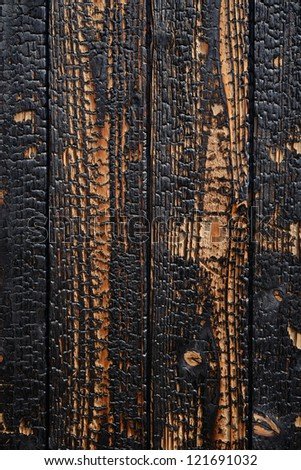 Close up of burnt wooden planks background - stock photo