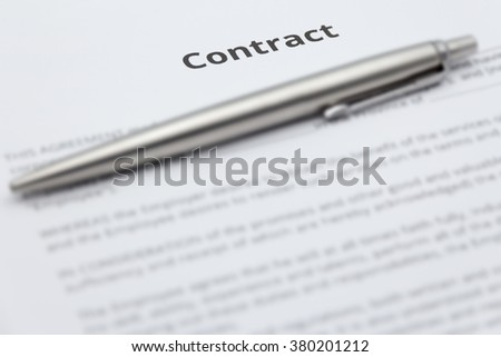 Close up of business contract document with pen.