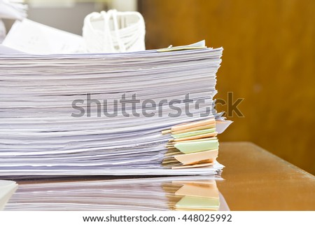 Close up of business documents stack on desk with selective focus