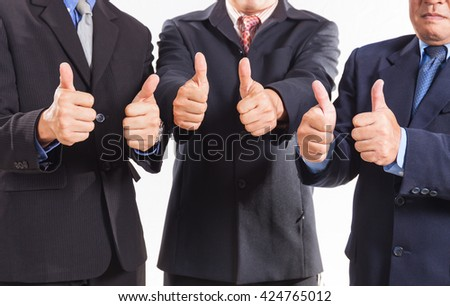 Close up of business group giving thumbs up - stock photo