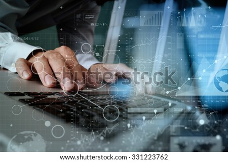 Close up of business man hand working on blank screen laptop computer on wooden desk as concept - stock photo