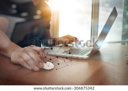close up of business man hand working on laptop computer on wooden desk                                                  - stock photo