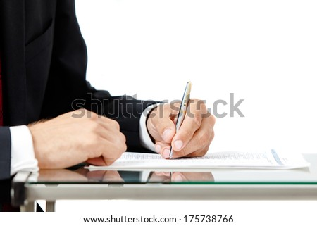 Close-up of business man signing a contract on white background. - stock photo