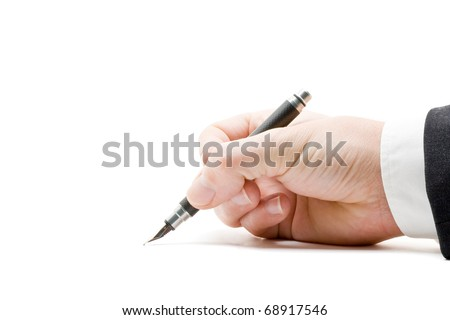 Close up of business mans hand signing paperwork with fountain pen - stock photo